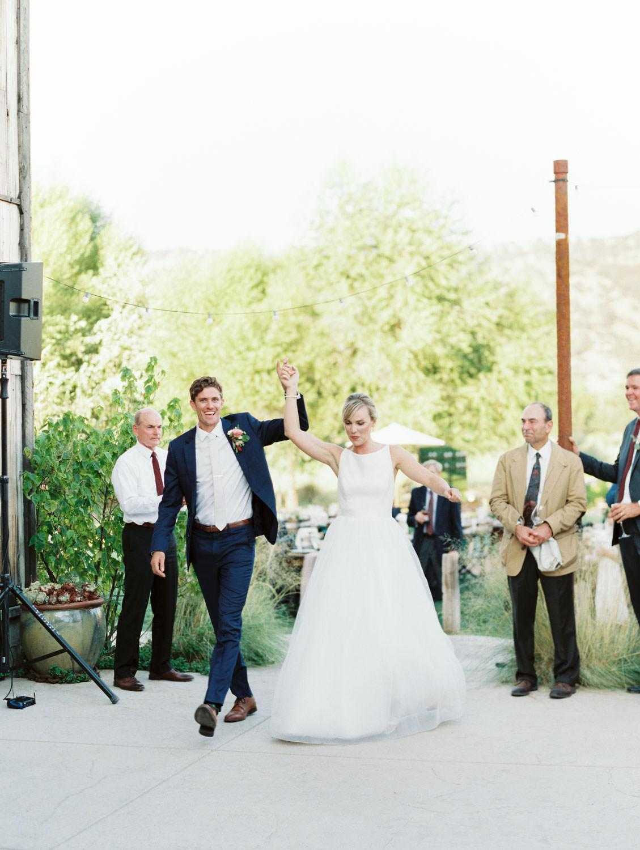 Bride and groom grand entrance. Full Belly Farm reception by film photographer Cavin Elizabeth Photography