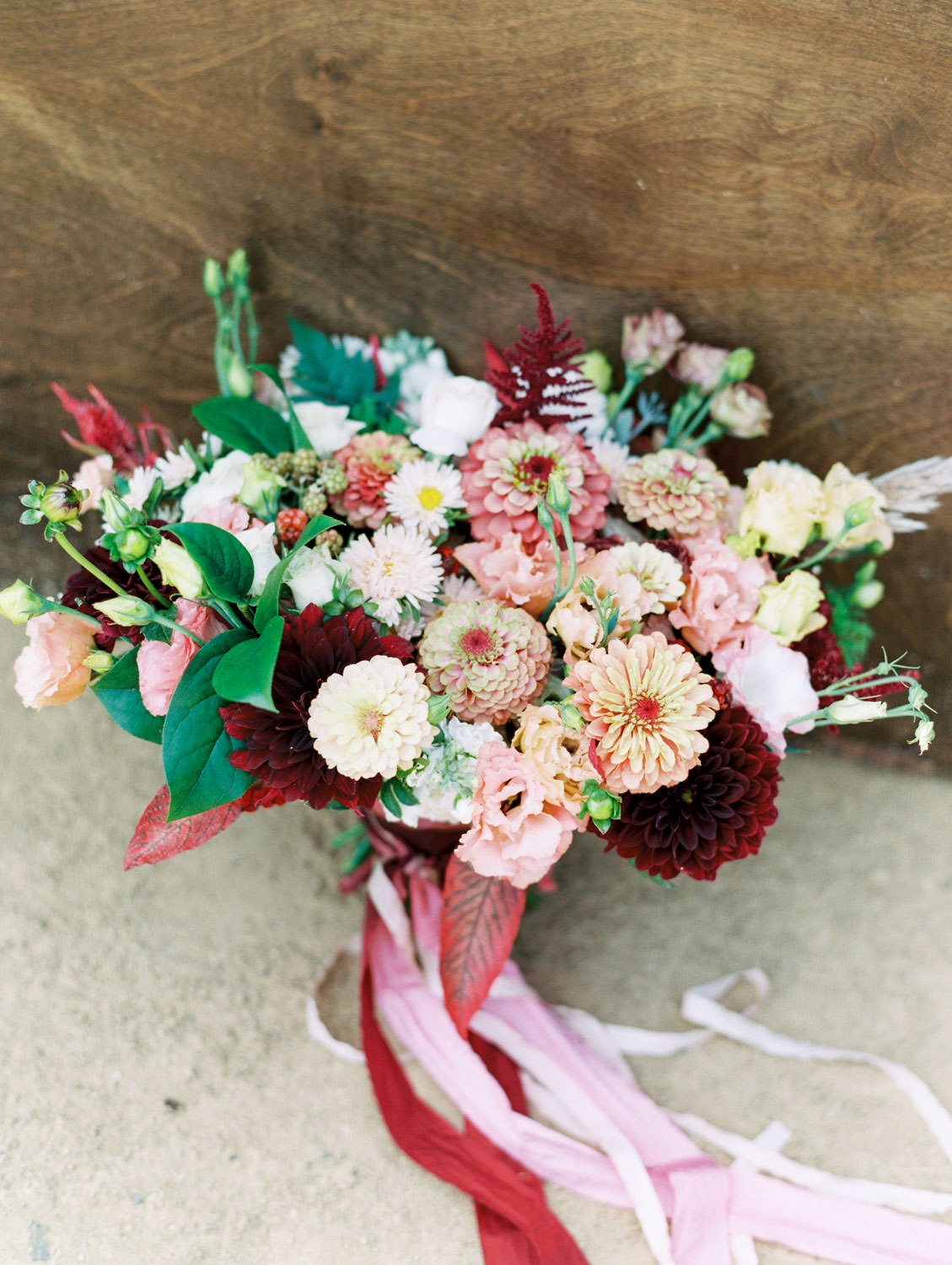 Bridal bouquet with ivory, peach, wine, blush flowers and mauve, wine, and blush ribbons. Full Belly Farm on Martha Stewart Weddings by film photographer Cavin Elizabeth Photography