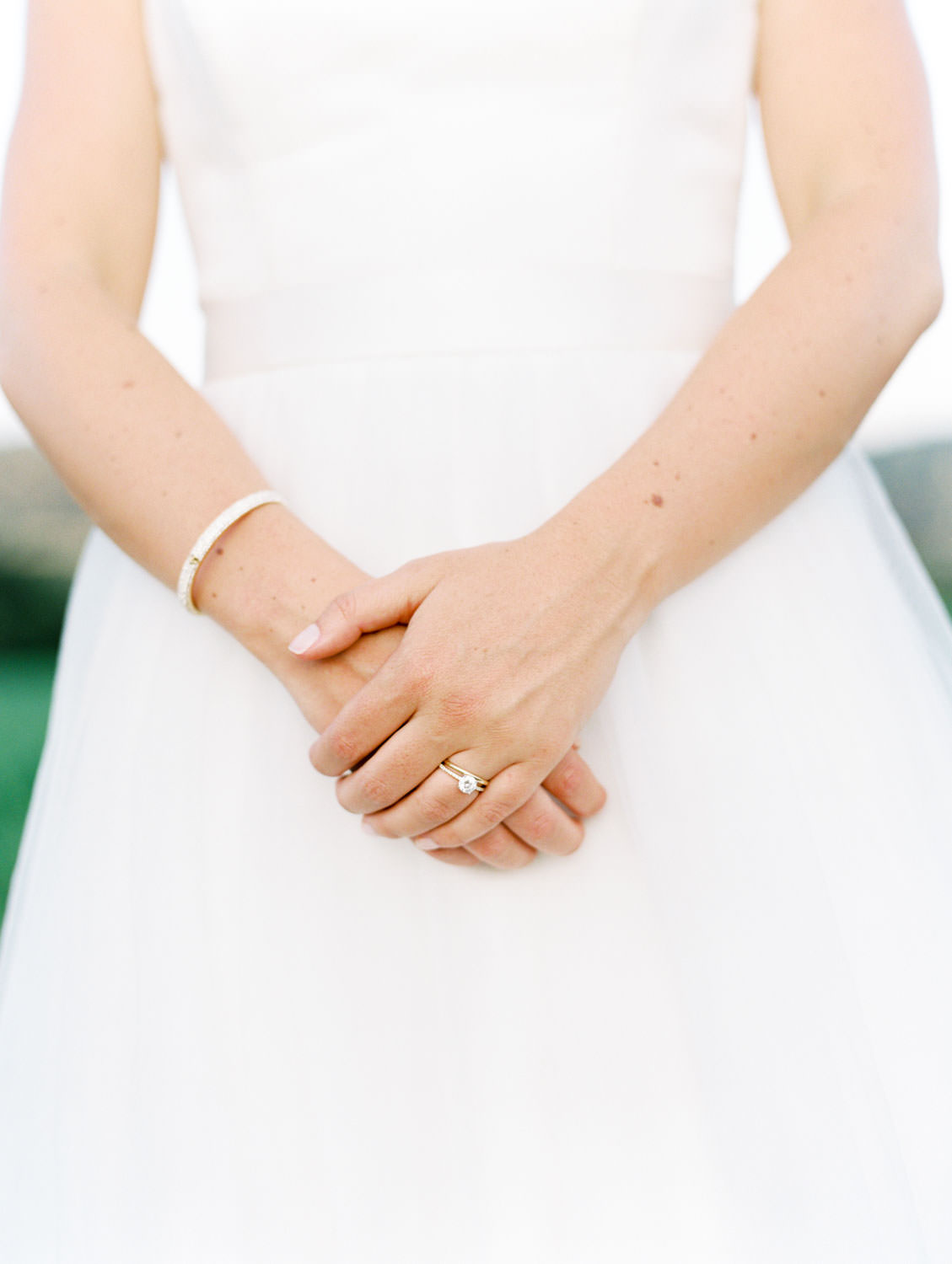 Bride soft hands portrait to show her rings and bracelet. Full Belly Farm reception by film photographer Cavin Elizabeth Photography