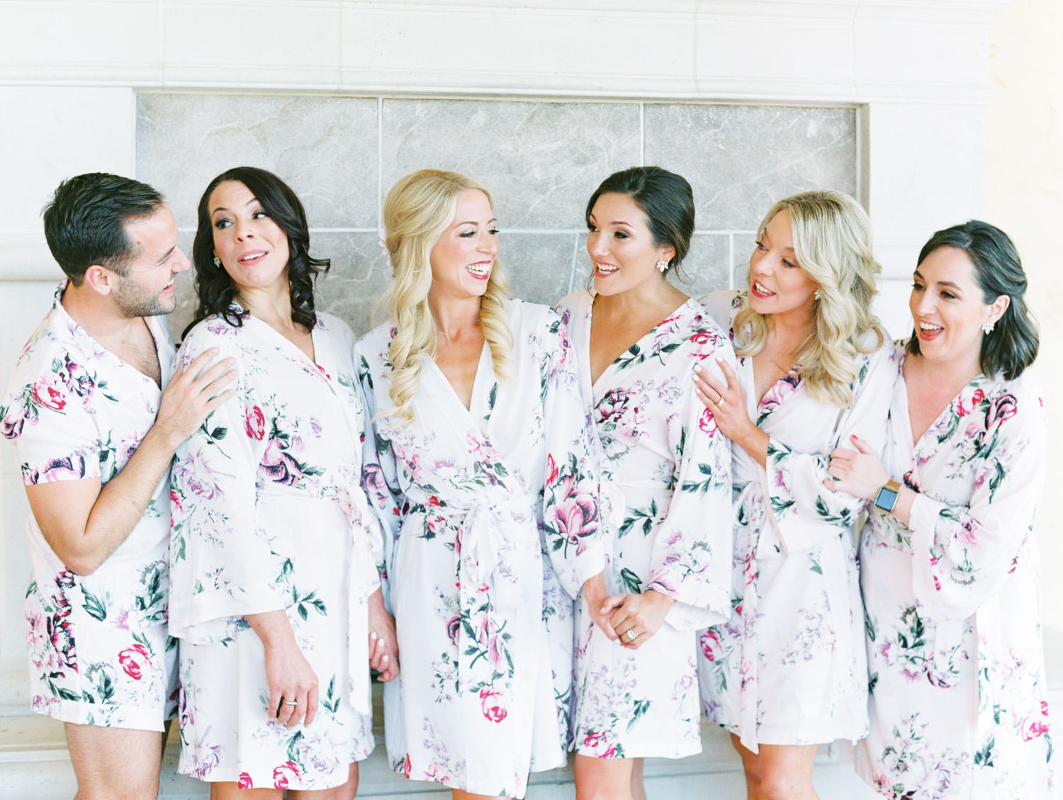 Bridesman in floral pjs to match bride and bridesmaids in floral robes. Miramonte Resort wedding. Film photography by Cavin Elizabeth.