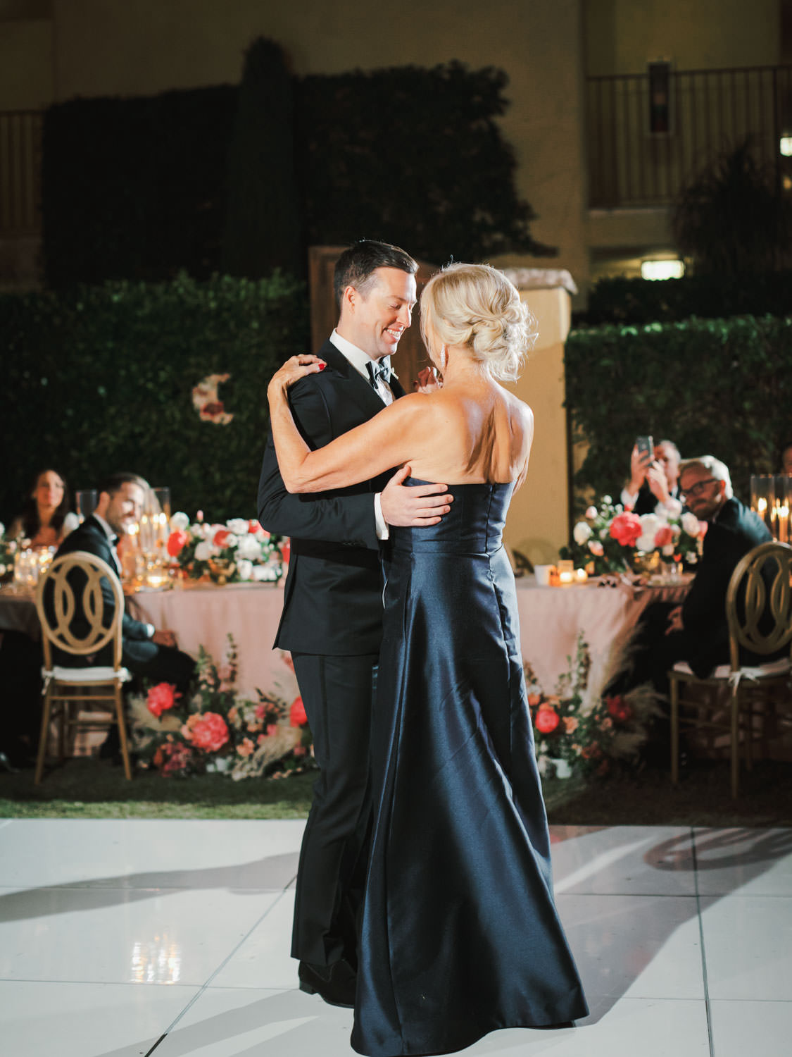 Mother son dance. Mother of the bride in a navy satin gown. Miramonte Resort wedding reception. Photography by Cavin Elizabeth.