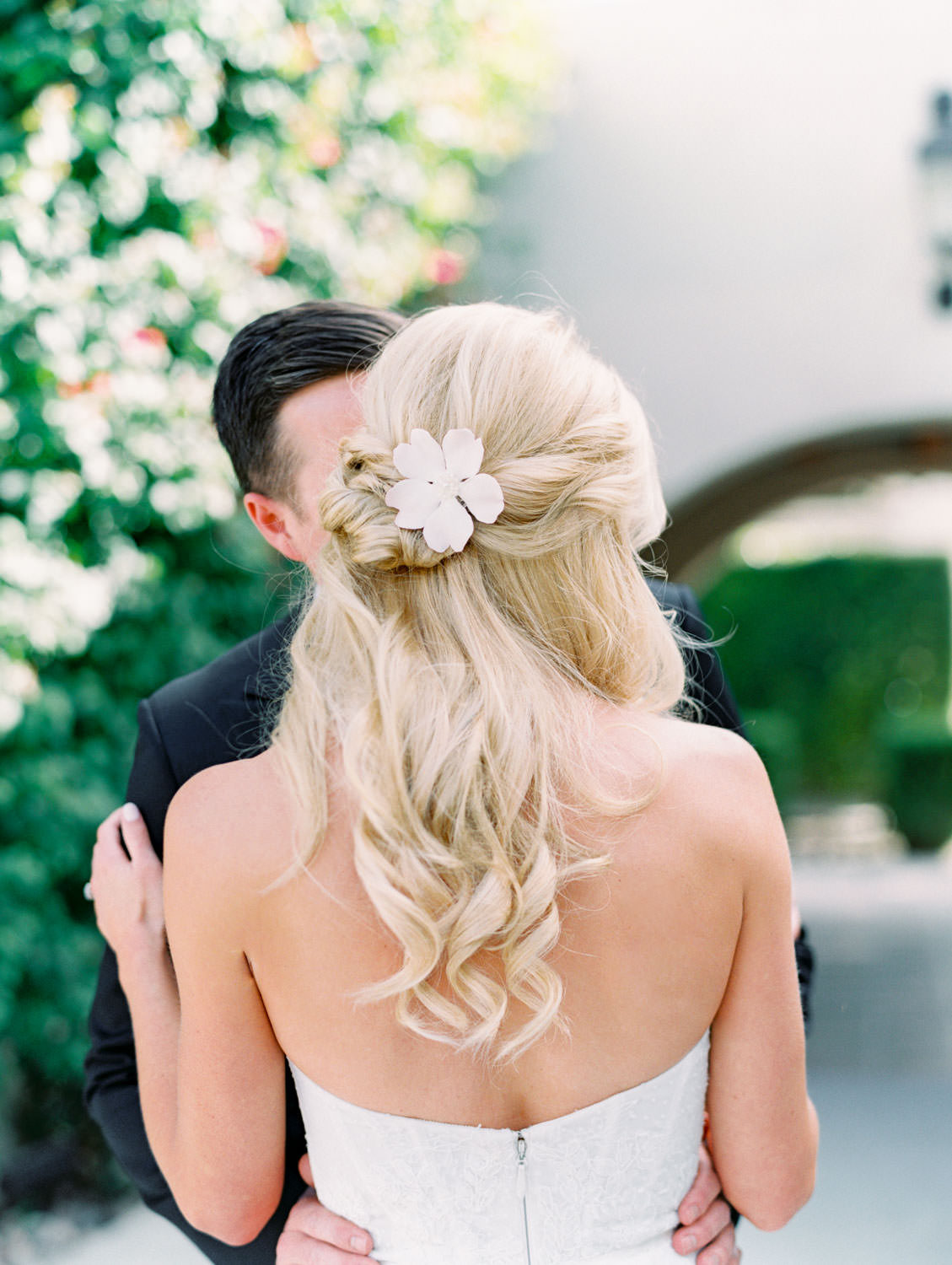 Bride's hair half up and curled with porcelain flower comb made by her mother. Miramonte Resort wedding. Film photography by Cavin Elizabeth.