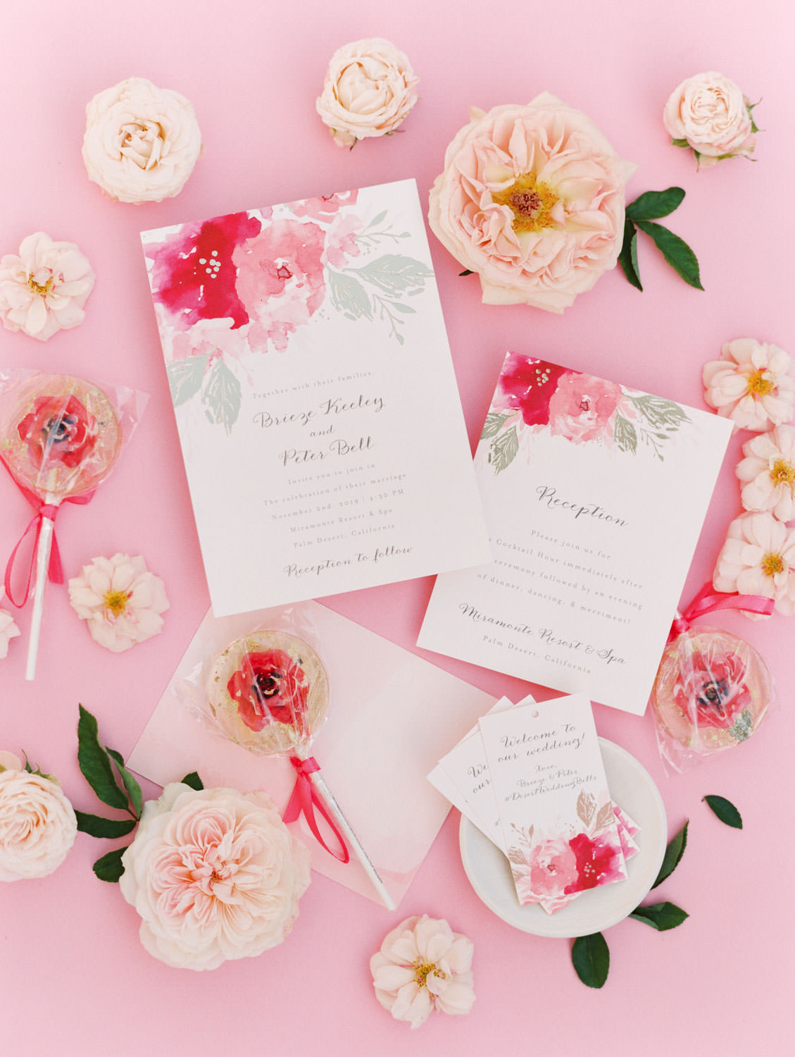 Minted pink floral wedding invitation suite with gold foil press. Custom pink floral lollipop (champagne flavor) styled with pink flowers. Film photography by Cavin Elizabeth.