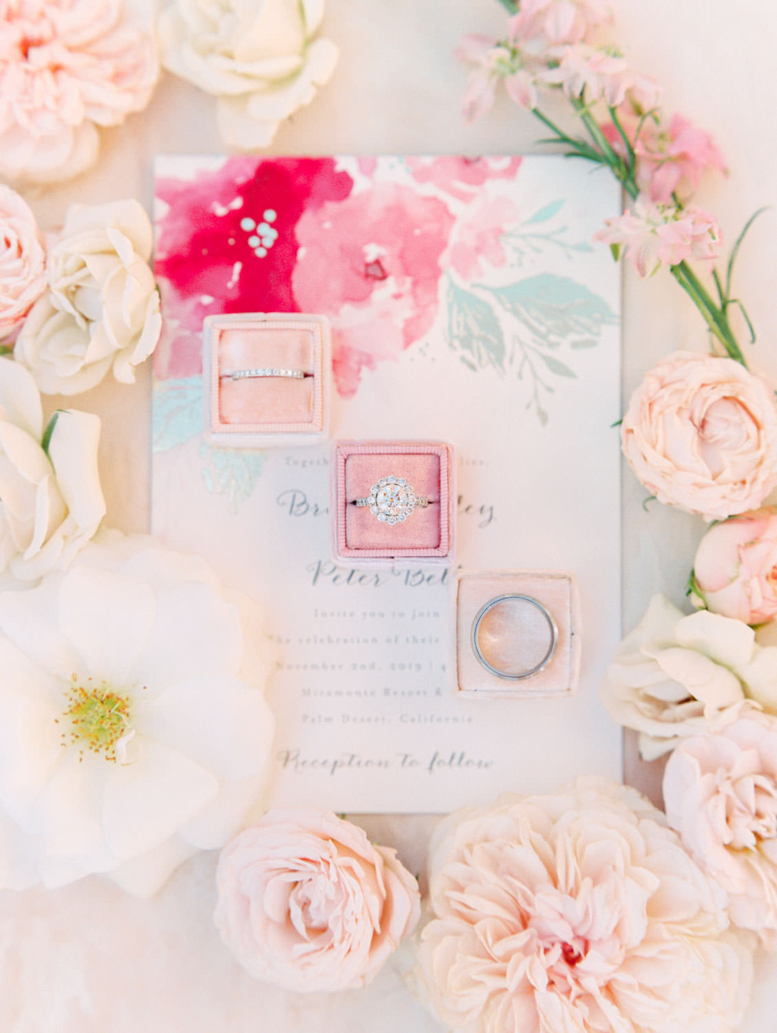 Wedding rings styled in pink Mrs Box velvet ring boxes. Minted pink floral wedding invitation suite with gold foil press. Film photography by Cavin Elizabeth.
