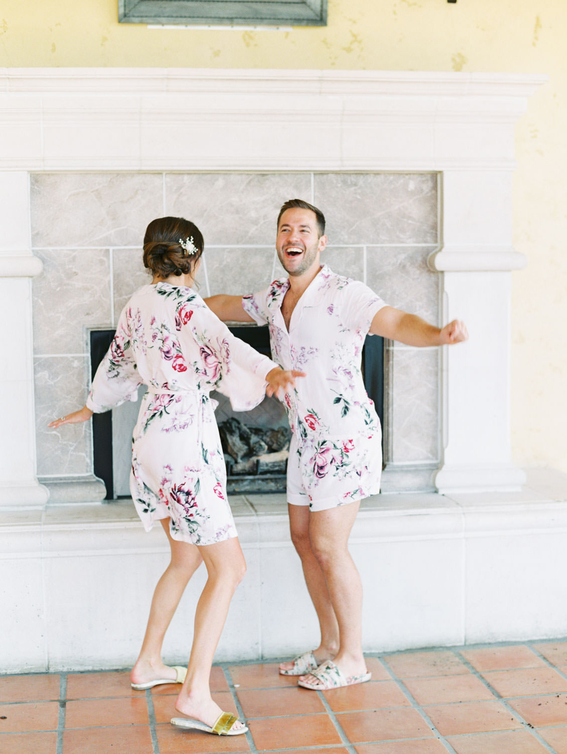 Bridesman in floral pjs to match bridesmaids in floral robes dancing and having fun before the wedding. Miramonte Resort wedding. Film photography by Cavin Elizabeth.