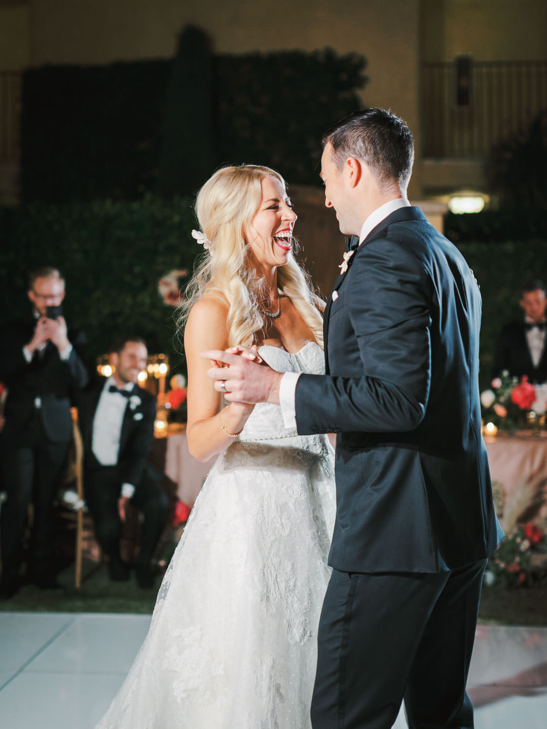 Bride and groom laughing during first dance. Miramonte Resort wedding reception. Photography by Cavin Elizabeth.
