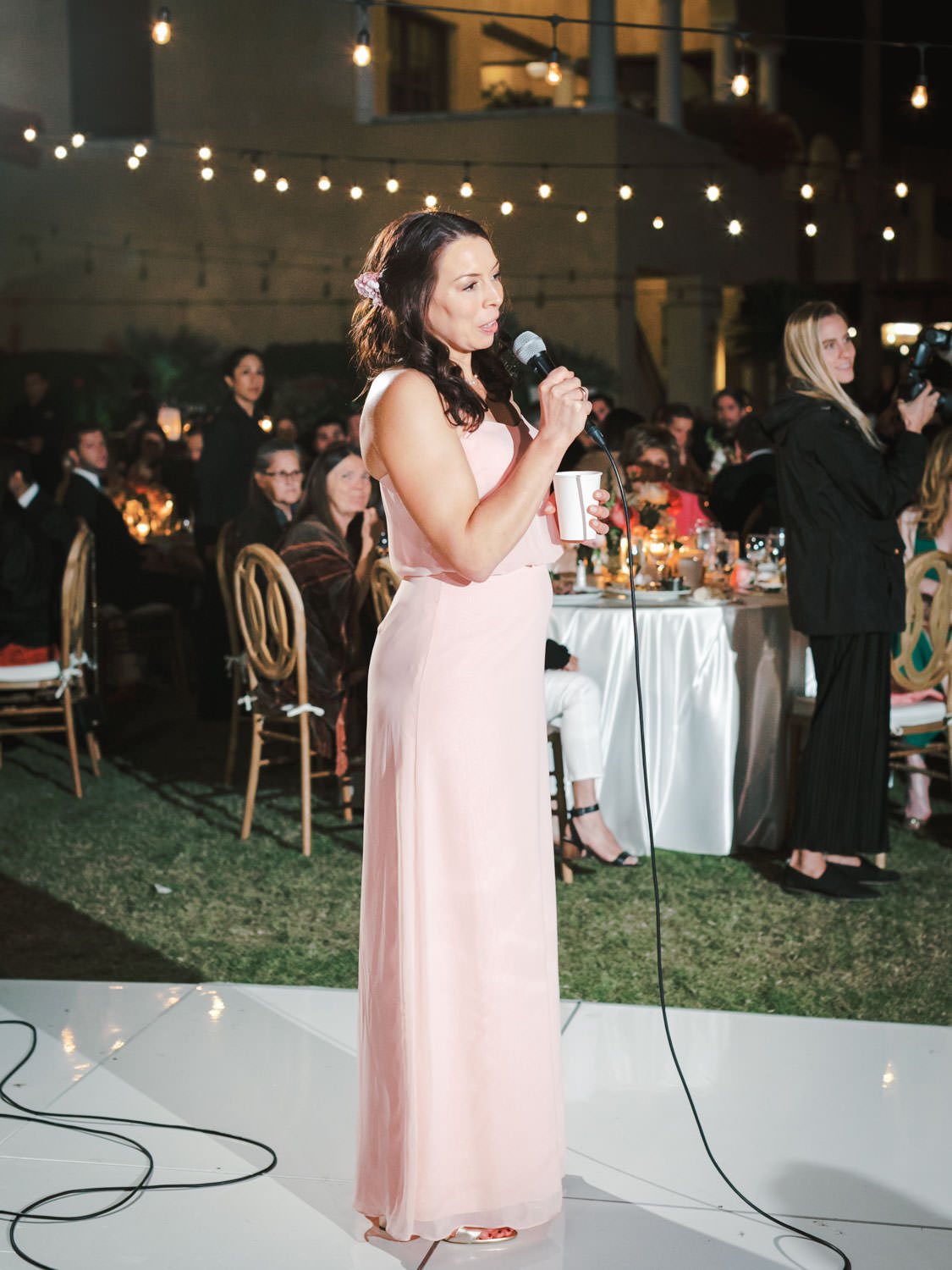 Maid of honor toast wearing a pink dress. Miramonte Resort wedding reception. Photography by Cavin Elizabeth.