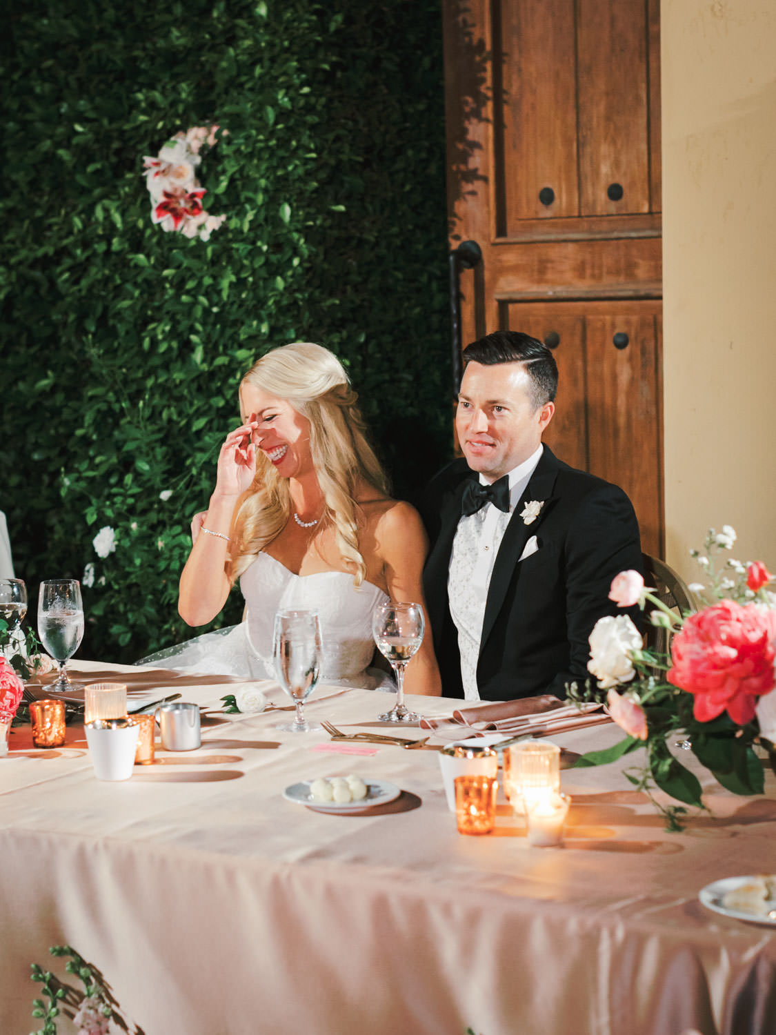 Bride and groom laughing at toast. Miramonte Resort wedding reception. Photography by Cavin Elizabeth.