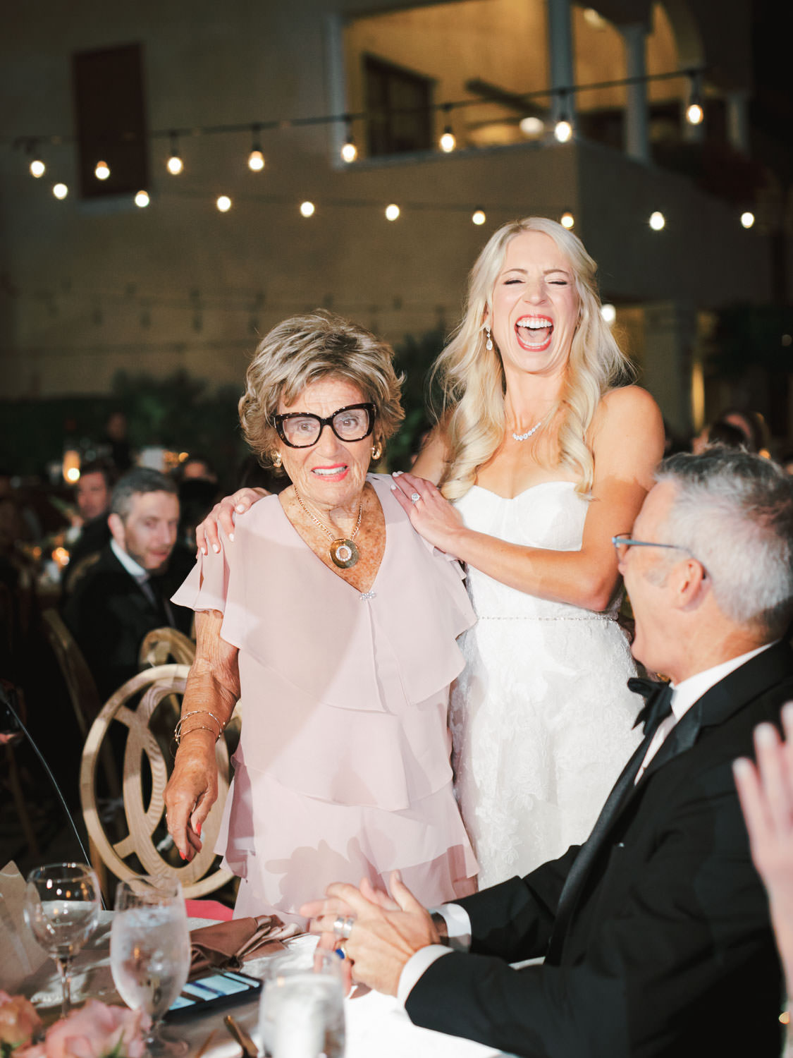 Bride laughing hysterically at her grandmother's wedding toast. Miramonte Resort wedding reception. Photography by Cavin Elizabeth.