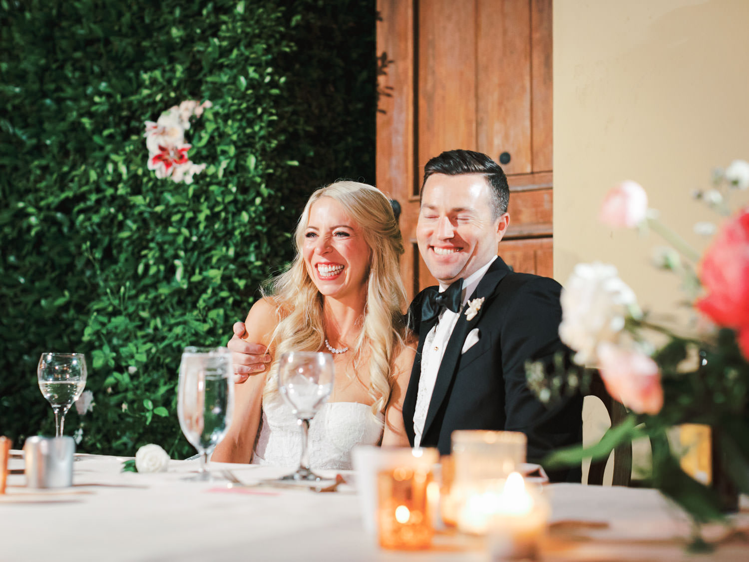 Bride and groom laughing at her father's toast. Miramonte Resort wedding reception. Photography by Cavin Elizabeth.