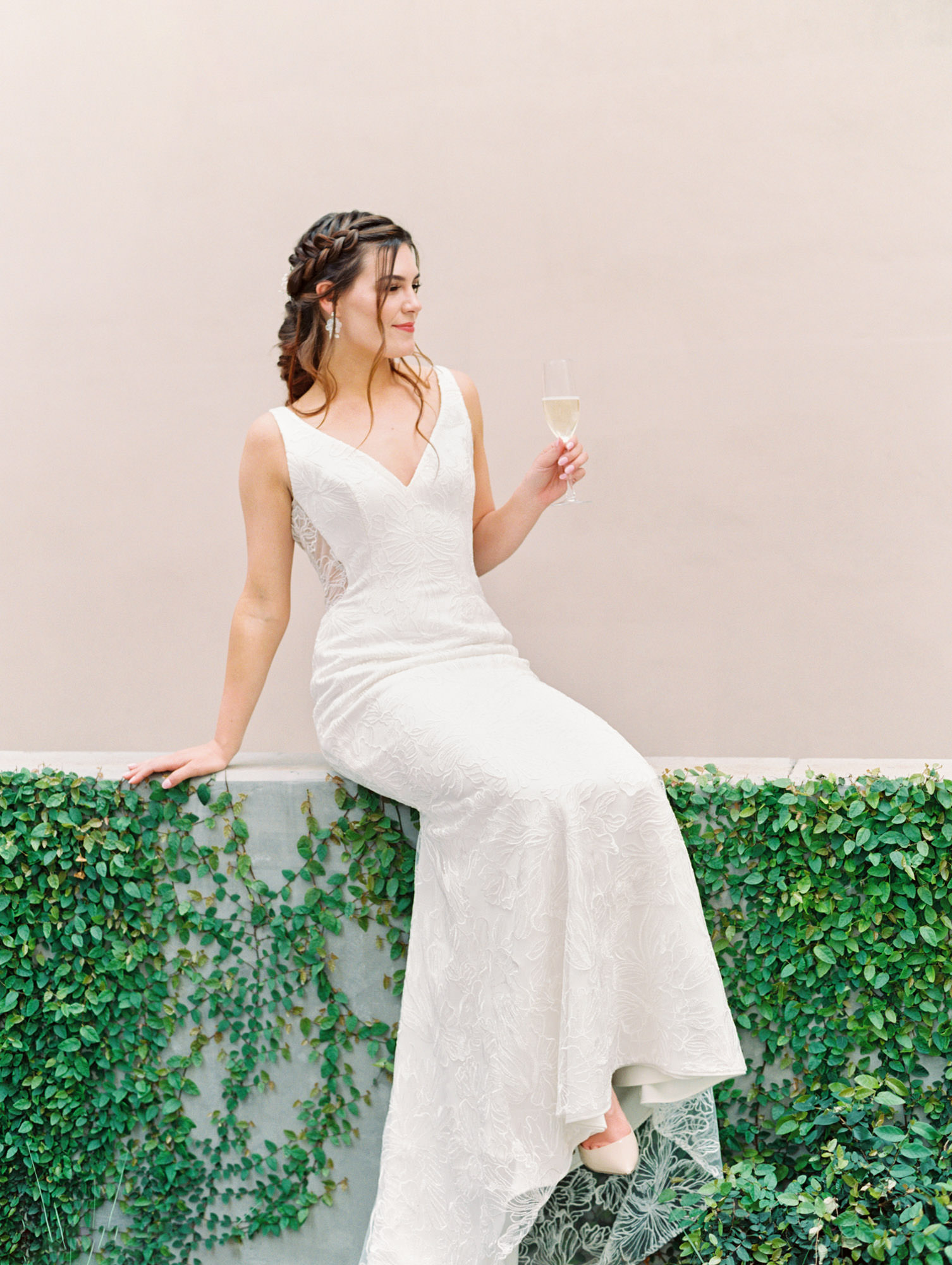 Low v neck crepe and beaded floral pattern with buttons all the way down the train. Gemma Kelly Faetanini wedding dress in San Diego by Cavin Elizabeth - San Diego film photographer. Wedding Fashion Inspiration.