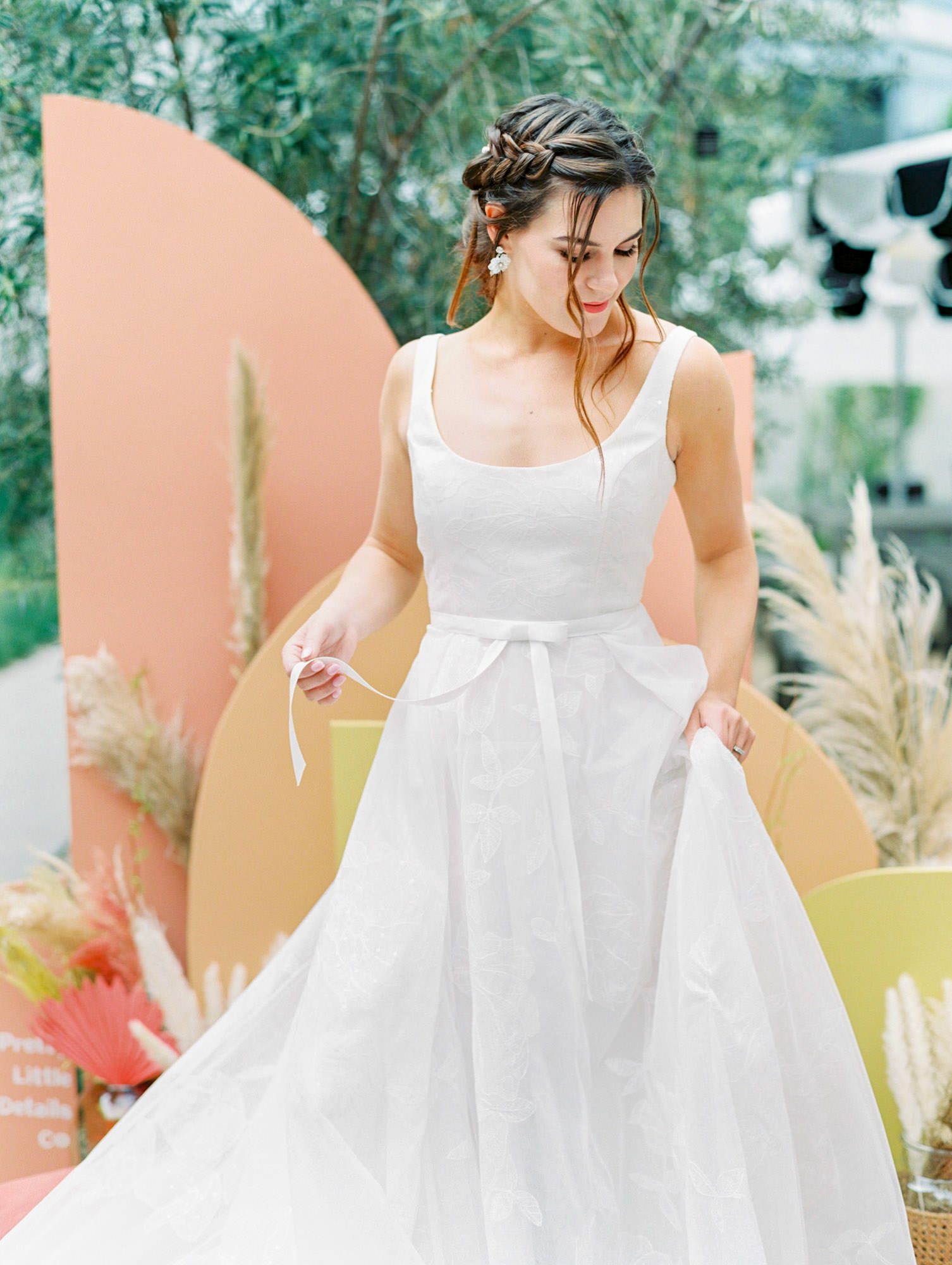 Sleeveless scoop neck with ivory ribbon around waist and floral pattern on skirt. Bea Marchesa Notte wedding dress in San Diego by Cavin Elizabeth - San Diego film photographer. Wedding Fashion Inspiration.