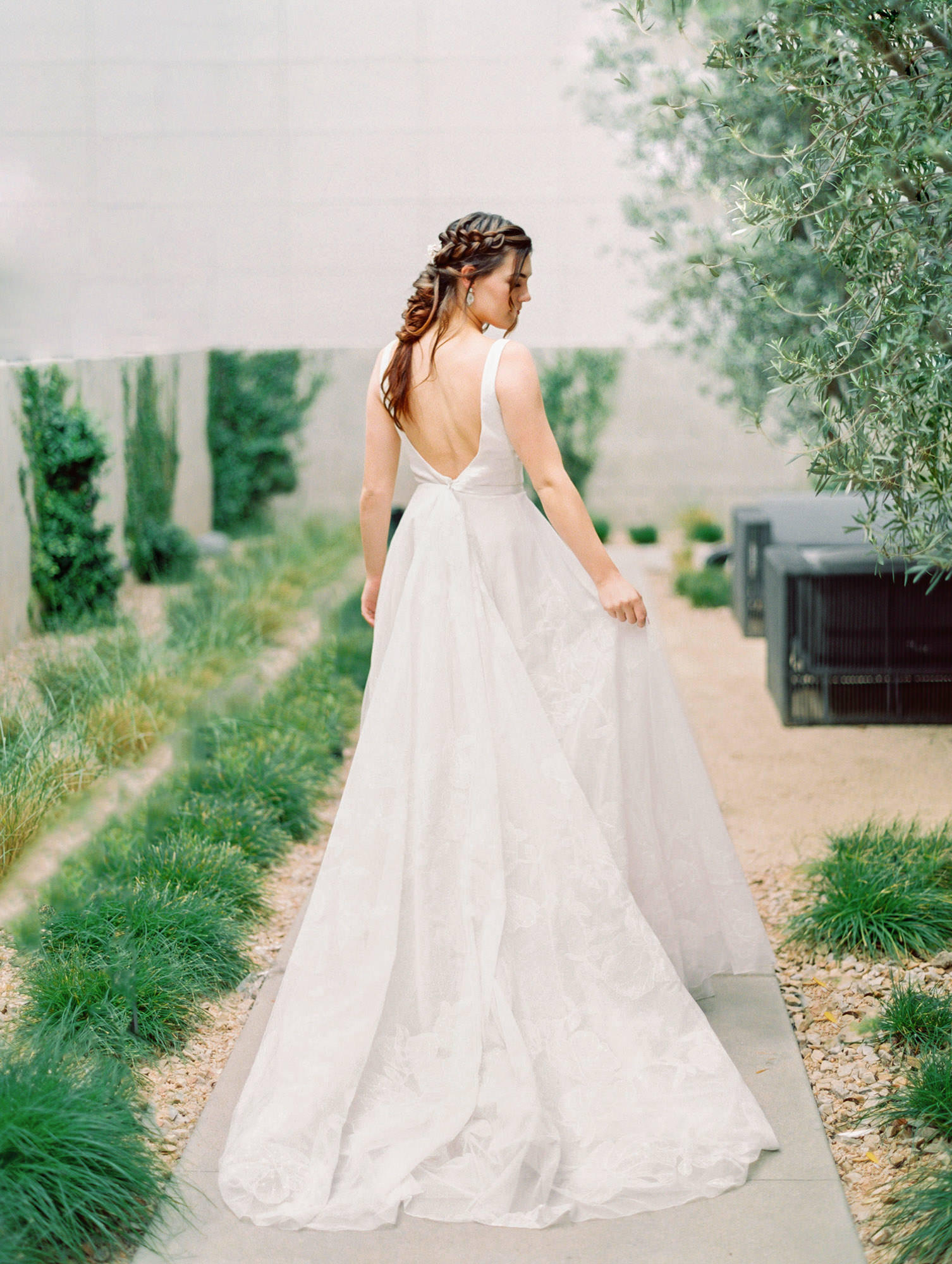 Sleeveless scoop neck with ivory ribbon around waist and floral pattern on skirt. Bea Marchesa Notte wedding dress in San Diego by Cavin Elizabeth - San Diego film photographer