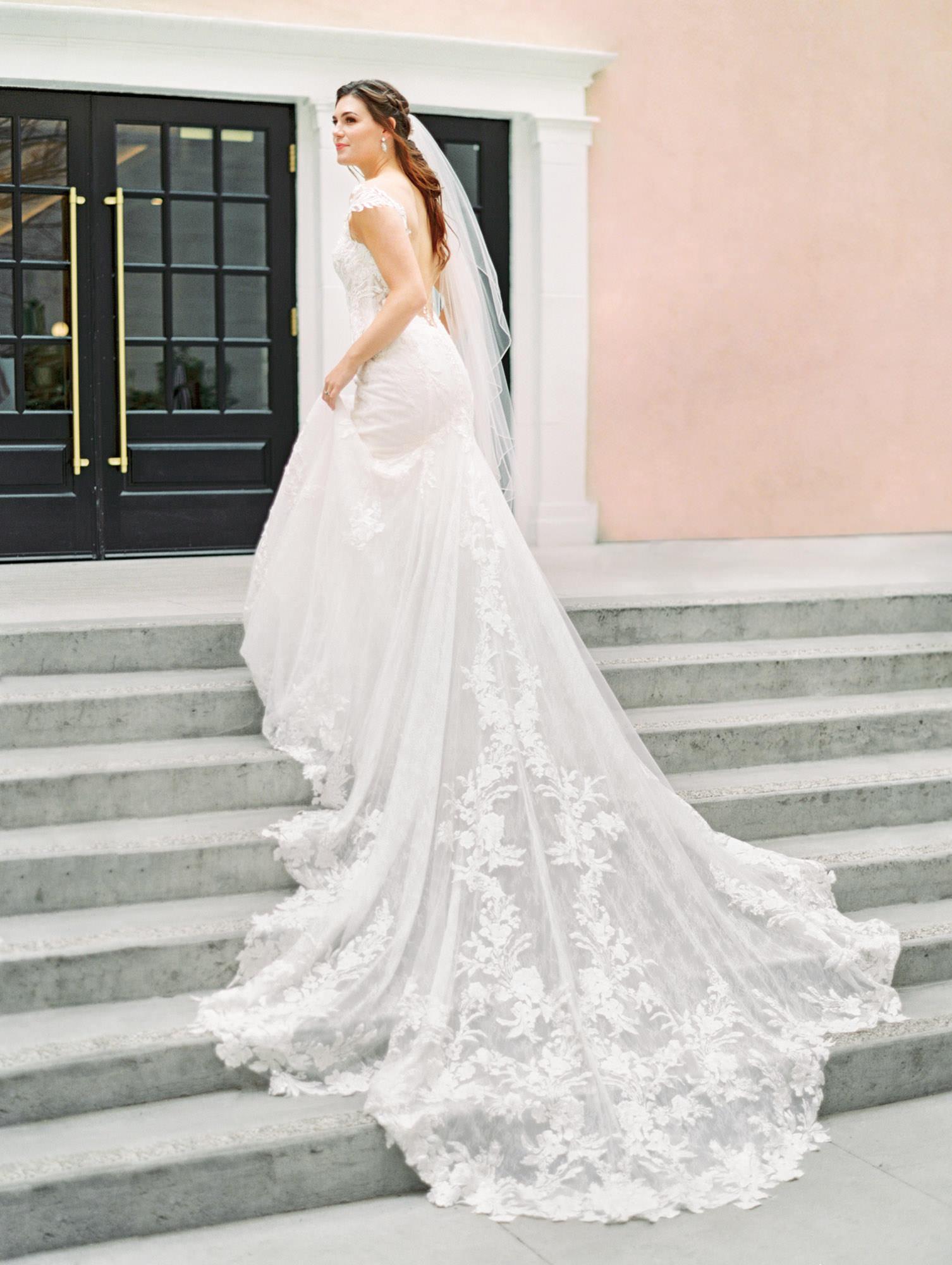 1104 cap sleeve lace dramatic drain with floral lace Martina Liana wedding dress in San Diego by Cavin Elizabeth - San Diego film photographer. Wedding Fashion Inspiration.