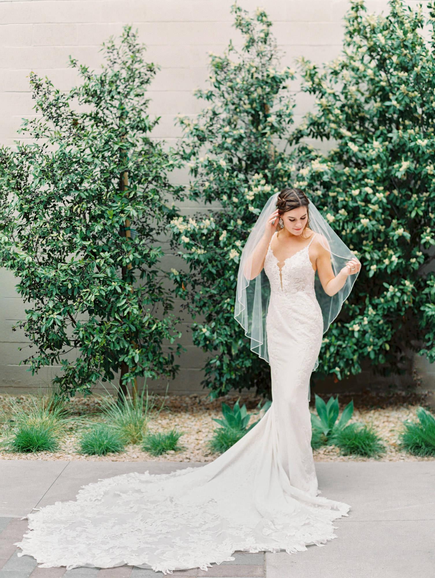 1165 floral beaded and crepe dramatic train Martina Liana wedding dress in San Diego by Cavin Elizabeth - San Diego film photographer