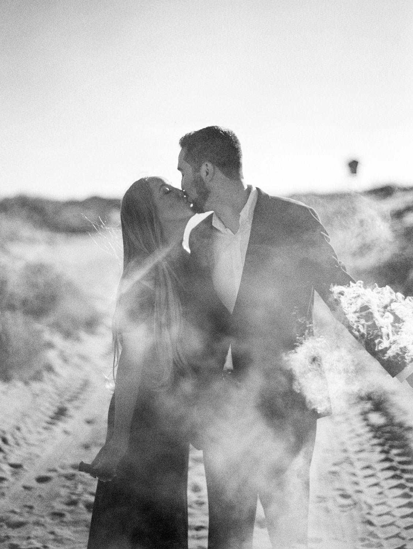 Smoke bombs with white smoke. Bride in navy velvet gown. Elegant Coronado Engagement Photos on the Beach on film by Cavin Elizabeth Photography.