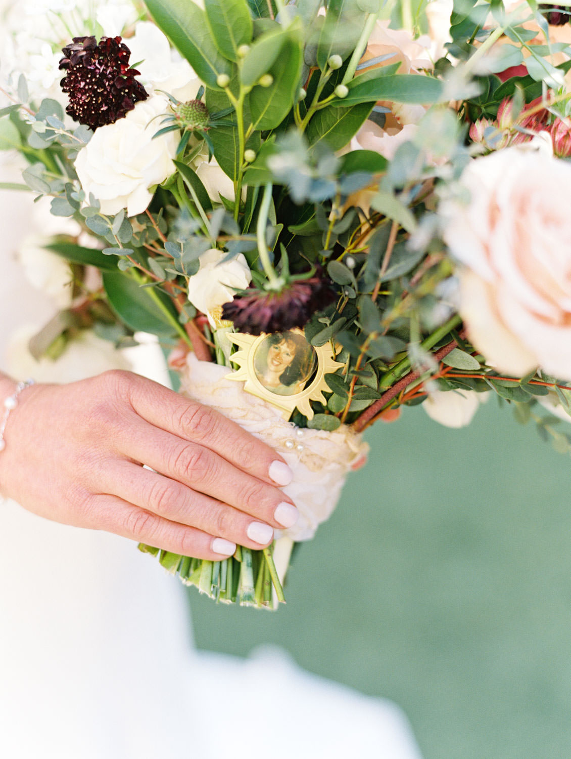 Bride's bouquet has a photo of her late mother and lace from her mother's wedding dress wrapped around the stems. How to honor a deceased parent at your wedding. Cavin Elizabeth Photography.
