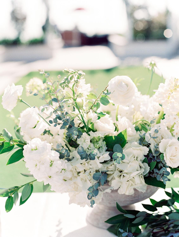Wedding welcome table ivory and green arrangement. Hotel Del Coronado wedding on film by Cavin Elizabeth.