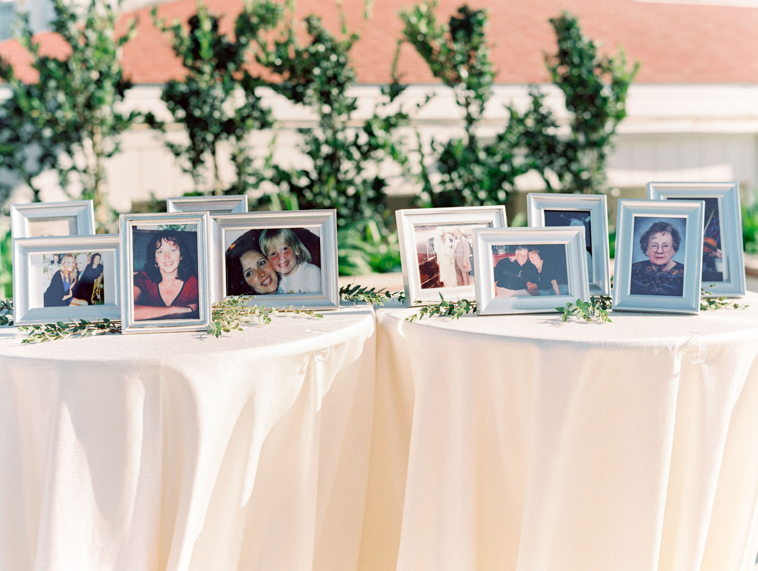 Wedding memorial table with photos of deceased loved ones.