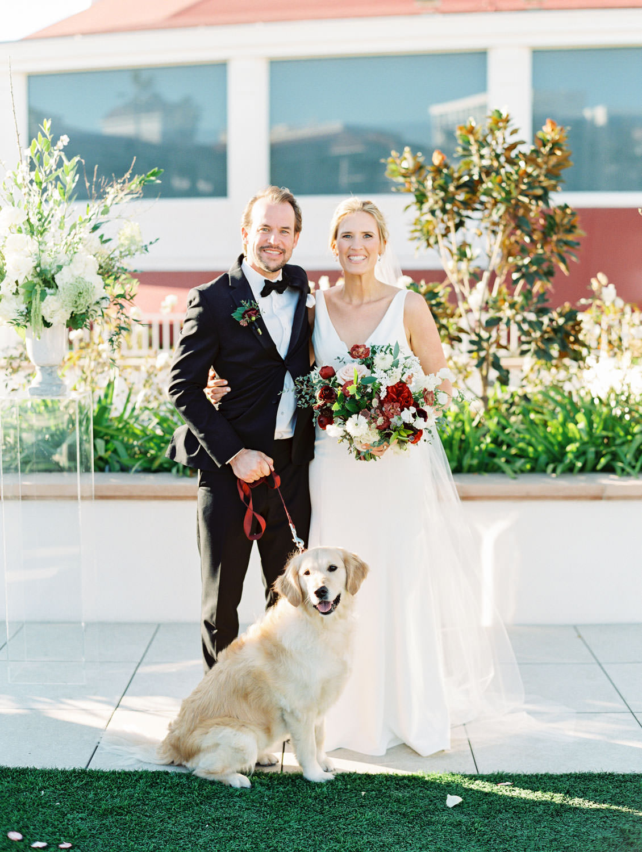 Bride and groom with their golden retriever ring bearer. Hotel Del Coronado wedding on film by Cavin Elizabeth.