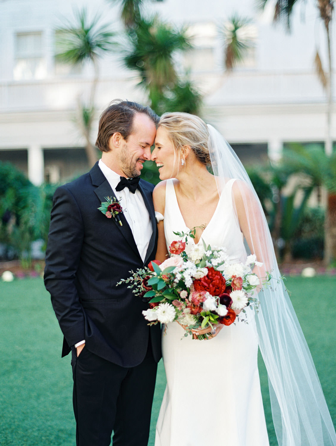 Bride and groom sharing a sweet moment. Bouquet with burgundy, blush, white, and greenery. Hotel Del Coronado wedding on film by Cavin Elizabeth.