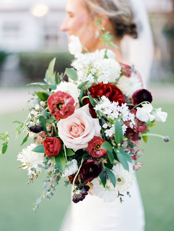 Bridal bouquet with burgundy peonies, white flowers, and greenery. Hotel Del Coronado wedding on film by Cavin Elizabeth.