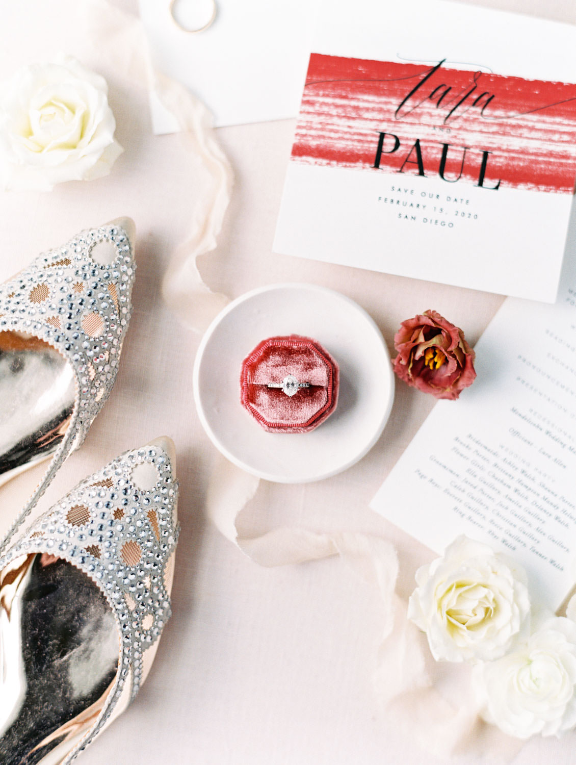 Modern wedding invitation with burgundy brush stroke styled with ring in velvet octagon ring box, earrings, and Badgley Mischka flats.