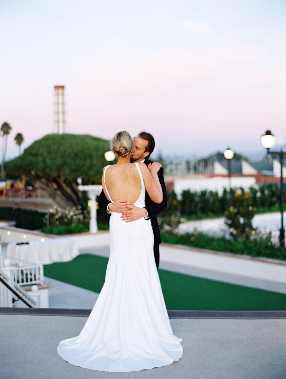 Bride and groom romantic sunset photo. Hotel Del Coronado wedding on film by Cavin Elizabeth.