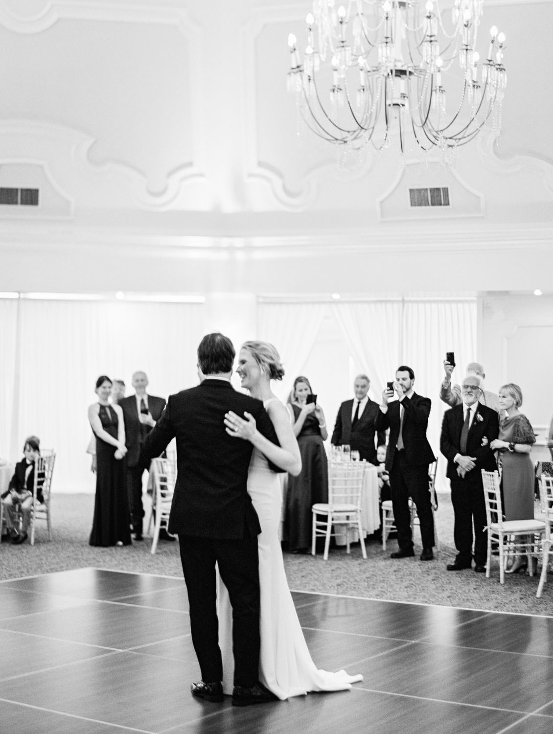 Black and white film photo of bride and groom on the dance floor. Hotel Del Wedding reception by Cavin Elizabeth.
