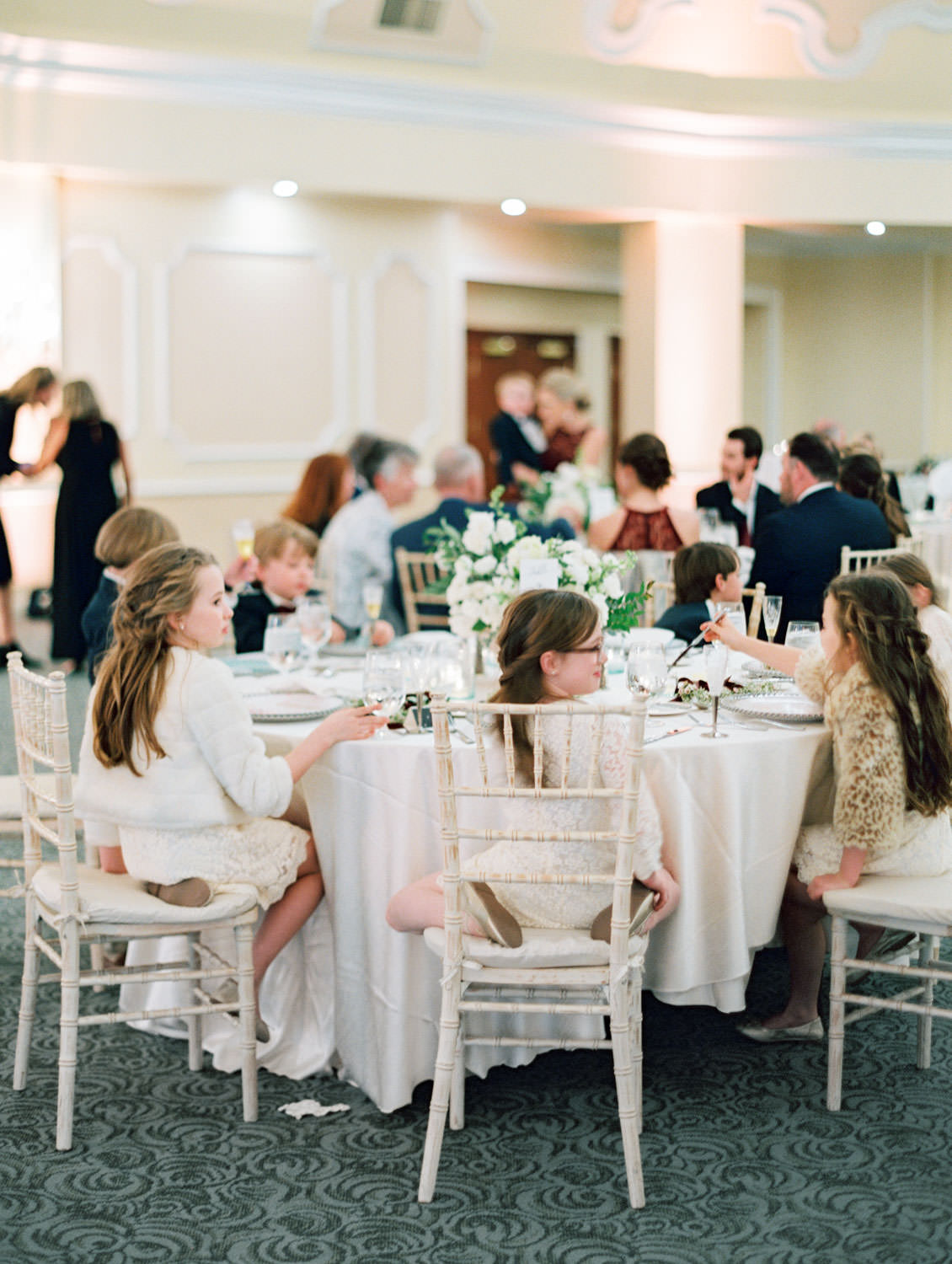 Flower girl table at reception watching the first dance. Hotel Del Wedding reception by Cavin Elizabeth.