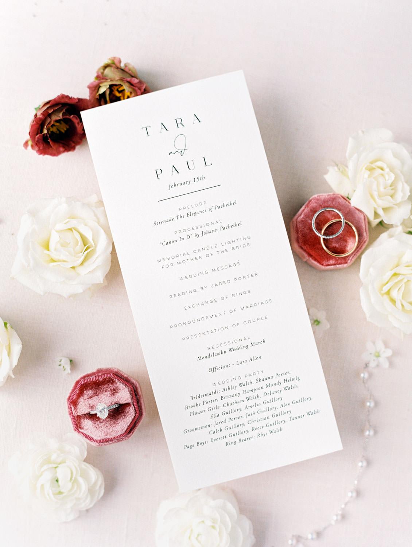 Rectangular vertical wedding ceremony program styled with ring in velvet octagon ring box.