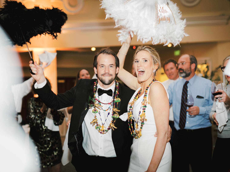 New Orleans second line with umbrellas and Mardi Gras beads. Hotel Del Wedding reception by Cavin Elizabeth.