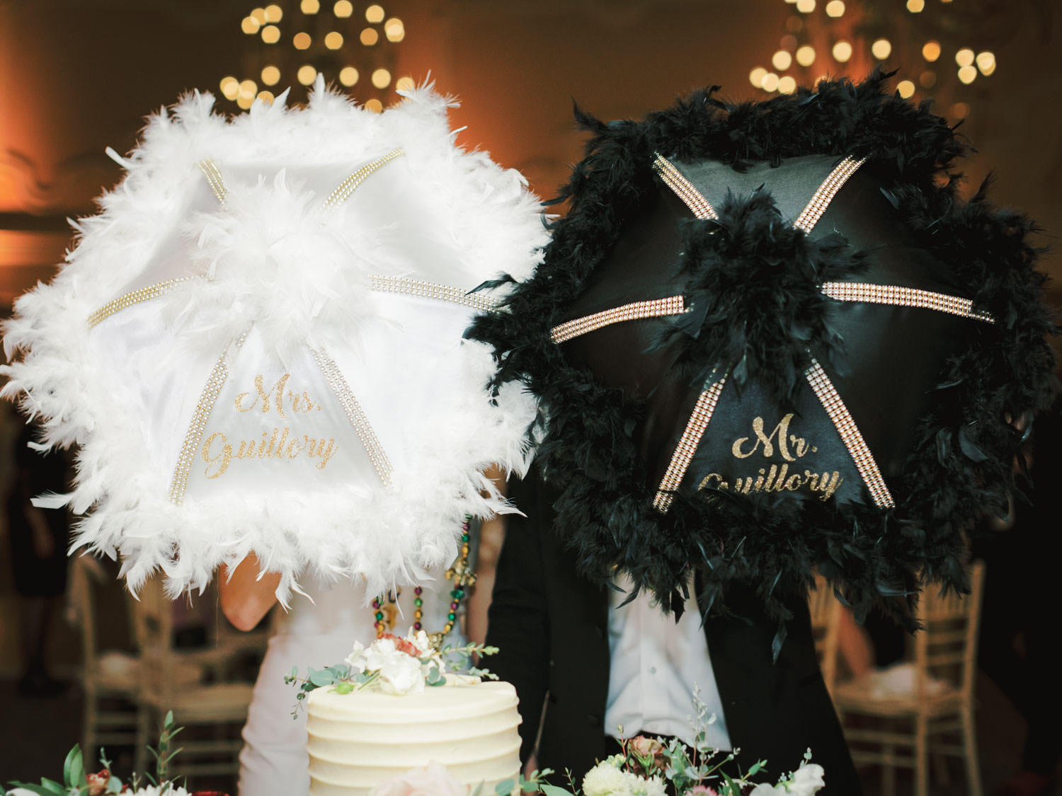 Bride and groom holding custom feather umbrellas for the New Orleans second line. Hotel Del Wedding reception by Cavin Elizabeth.