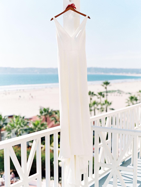 Jenny Yoo wedding dress from BHLDN with a view of the ocean behind. Hotel Del Coronado Wedding on film by Cavin Elizabeth.