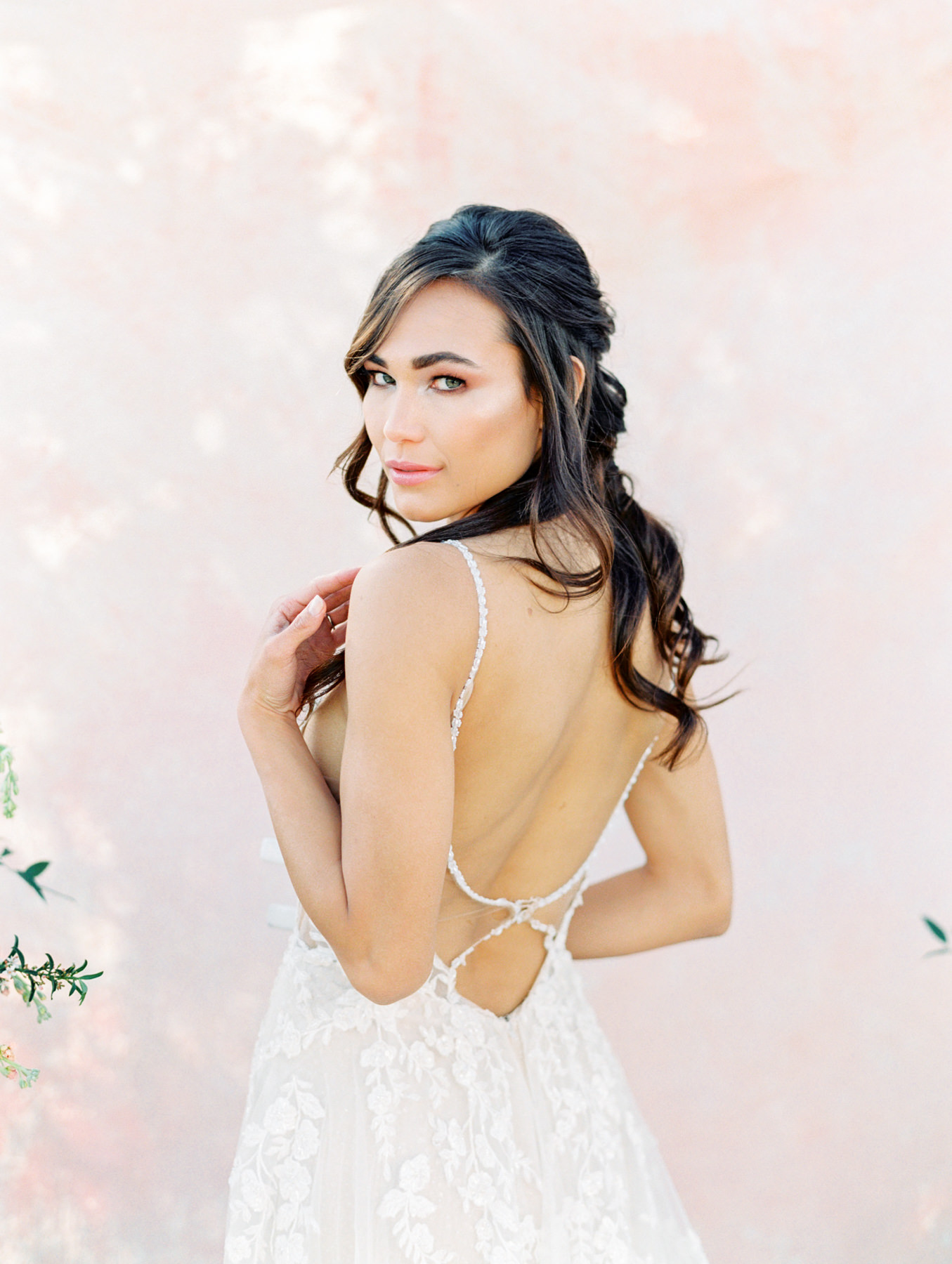 Pink painterly backdrop. Martina Liana 1137 (Delicately beaded shoestring straps, V-neckline. V-sides and sheer bodice, laces featuring a mix of vine-like and floral patterns) gown from The White Flower. Hair half up and curled with dainty floral Brides and Hairpins comb. Cavin Elizabeth Photography - film photographer in San Diego.