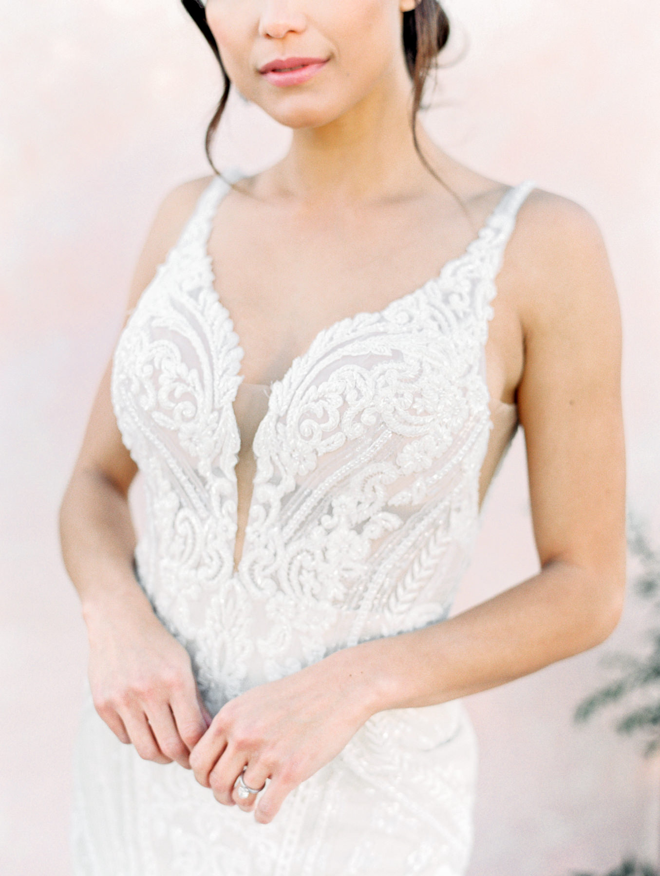 Martina Liana 1066 sleeveless deep plunge neck beaded lace gown from The White Flower. Cavin Elizabeth Photography - film photographer in San Diego. Wedding Dresses by Martina Liana in San Diego.