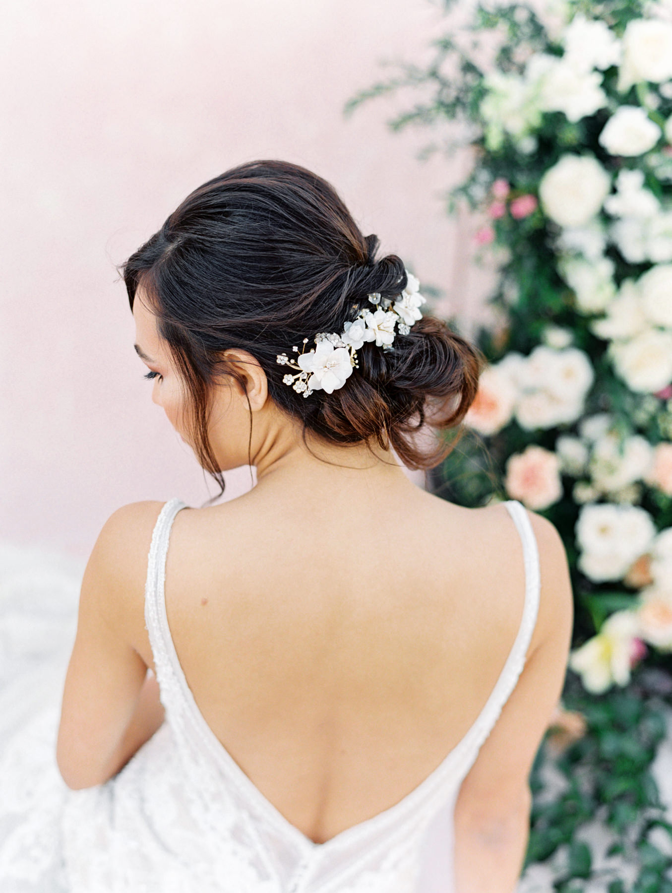 Twigs and Honey white floral hair accessory in a bridal updo. Martina Liana 1066 beaded lace gown from The White Flower. Cavin Elizabeth Photography - film photographer in San Diego.