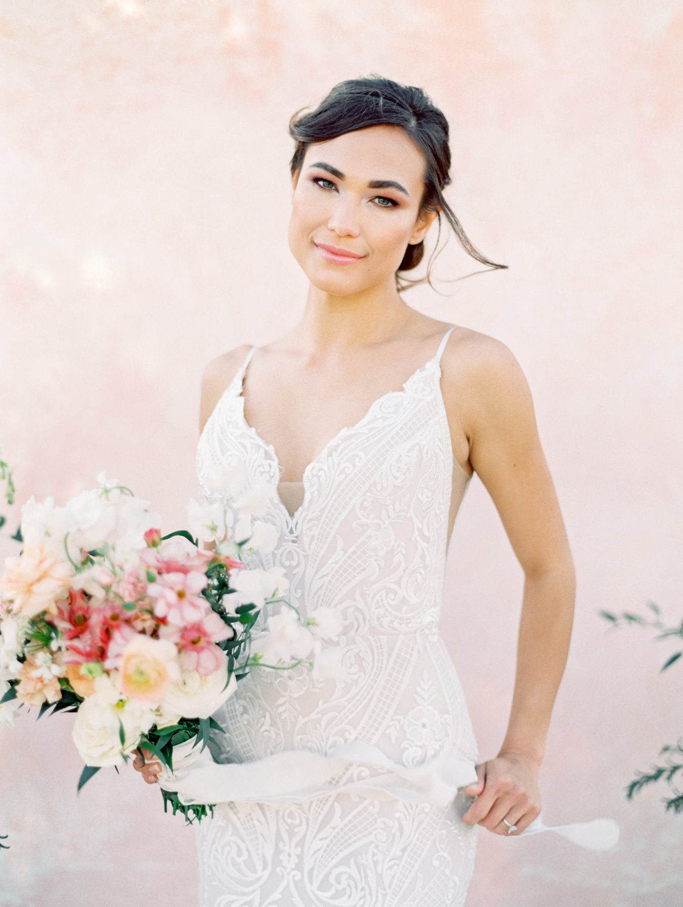 Bridal bouquet with ivory, pink, peach, carnations, roses, ranunculus, sweet peas, and greenery. Hayley Paige Zazu gown from The White Flower. Cavin Elizabeth Photography - film photographer in San Diego.