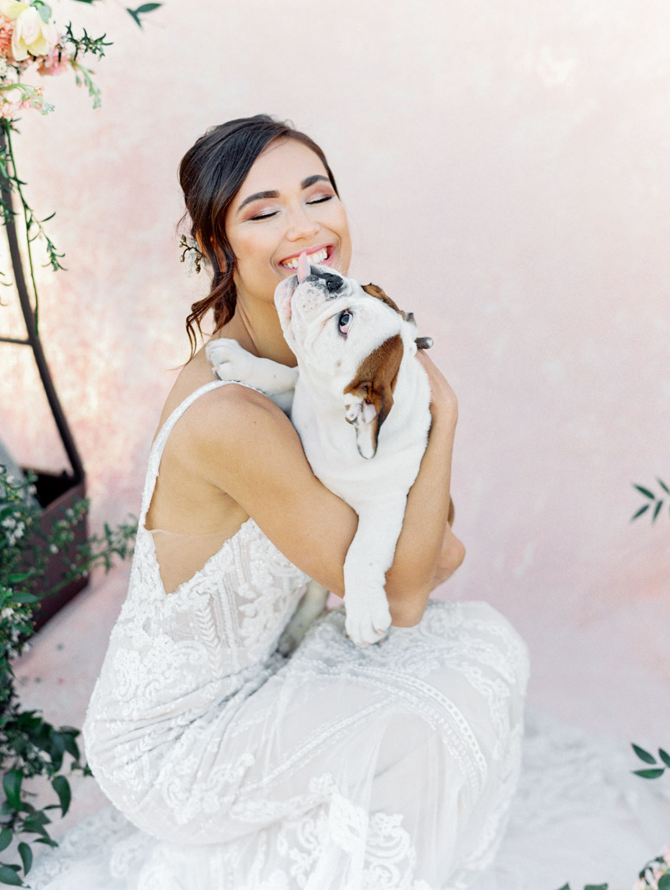 Bride being kissed by a French bulldog. Martina Liana 1066 beaded lace gown from The White Flower. Cavin Elizabeth Photography - film photographer.