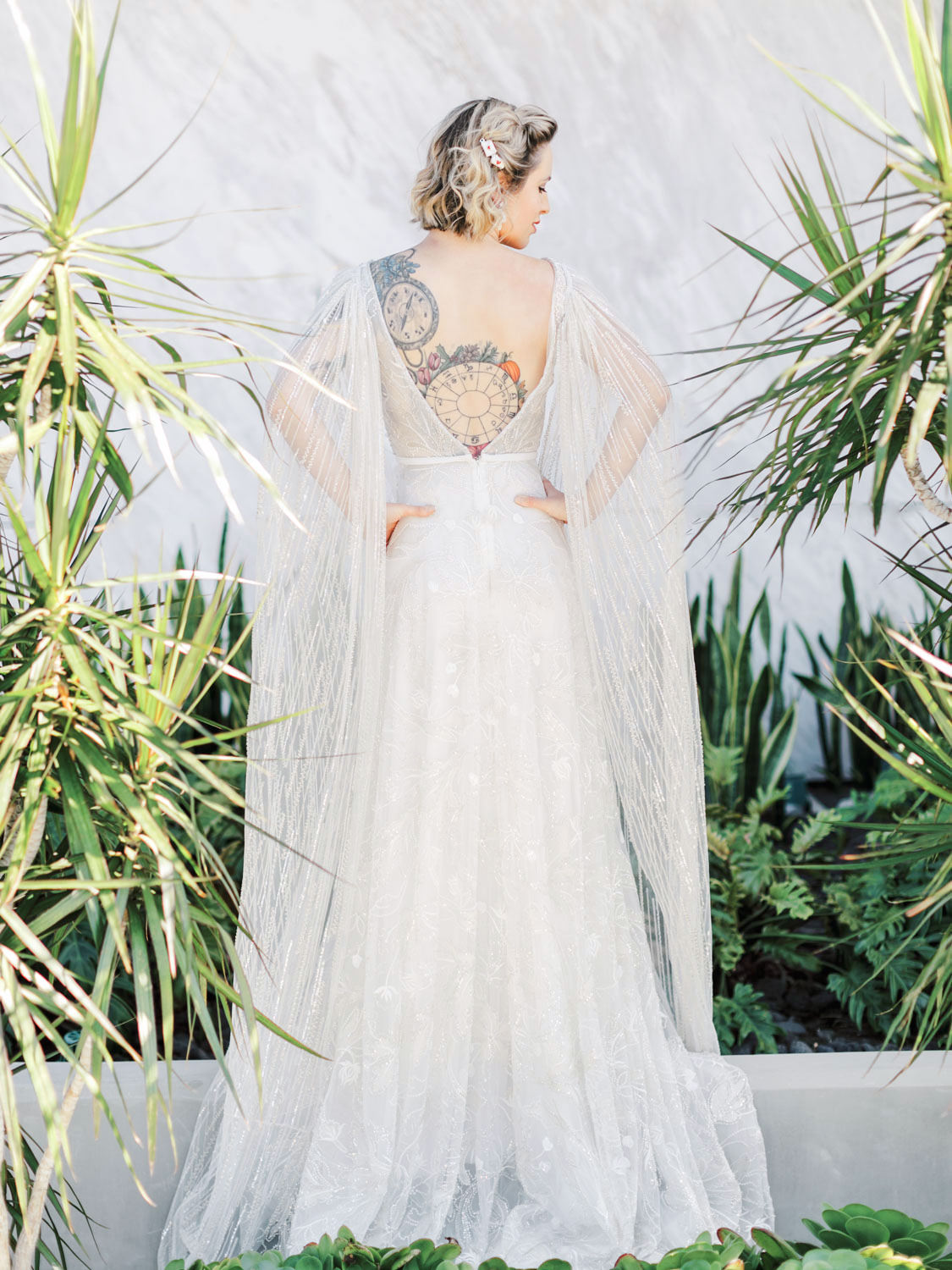 Neta Dover Camila - A Luxury Wedding Dress with cape sleeves and floral beading. Cavin Elizabeth Photography