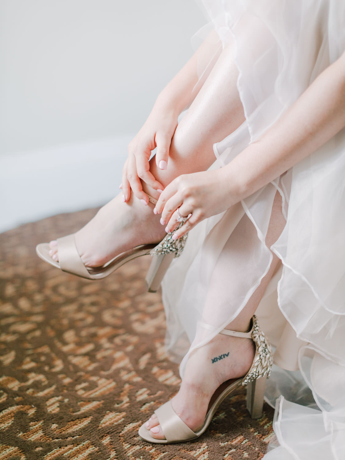 Bride getting into her shoes. Film photography at Jekyll Island Club Resort Wedding by Cavin Elizabeth Photography