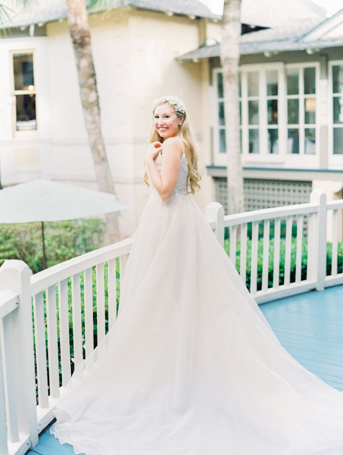 Bride in a champagne gown with a floral tiara headband. Film photography at Jekyll Island Club Resort Wedding by Cavin Elizabeth Photography
