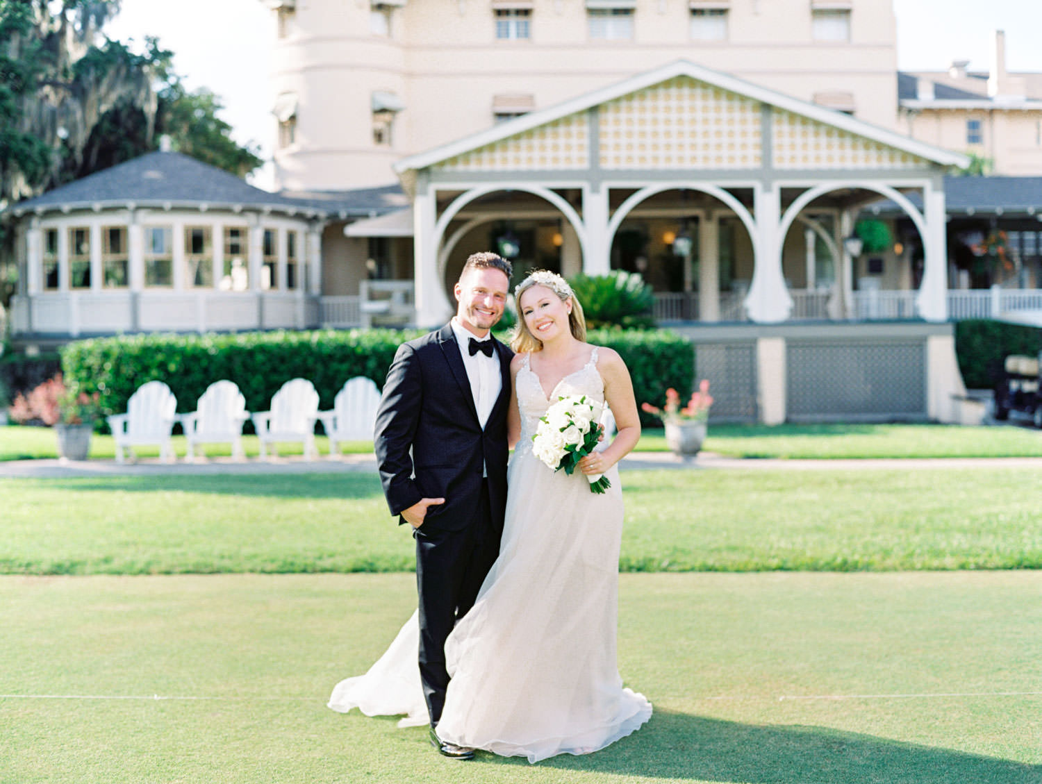 Portrait of the bride and groom. Wedding film photography at Jekyll Island Club Resort by Cavin Elizabeth Photography