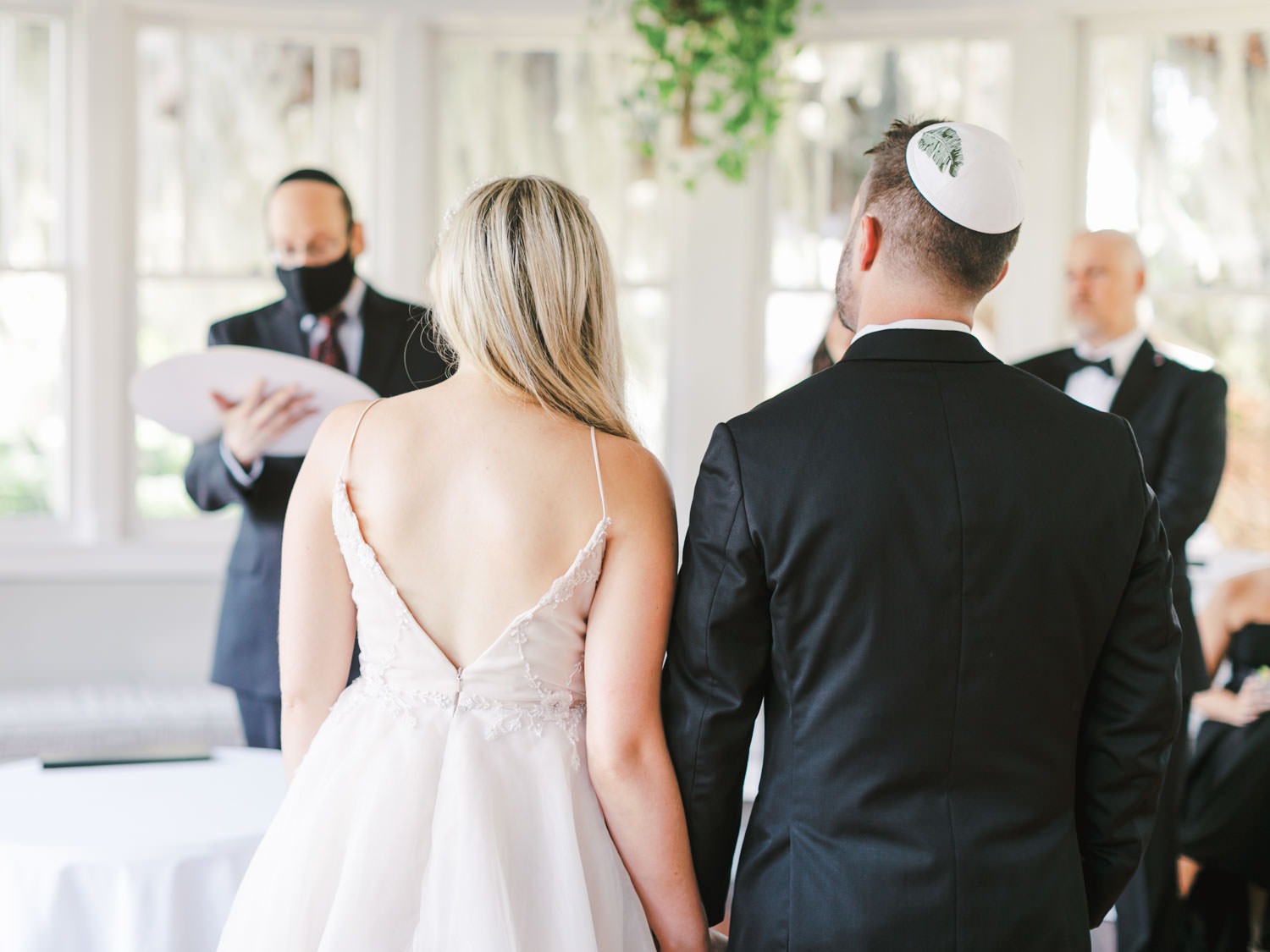 Intimate ketubah signing with white yarmulke with a banana leaf embroidered. Jekyll Island Club Resort Wedding by Cavin Elizabeth Photography