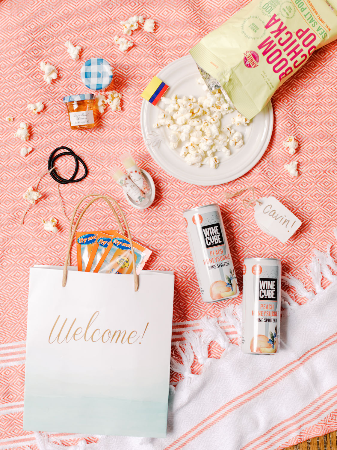Welcome bag with popcorn, honey, canned wine, chapstick, sunscreen, and hairties. Wedding film photography at Jekyll Island Club Resort by Cavin Elizabeth Photography