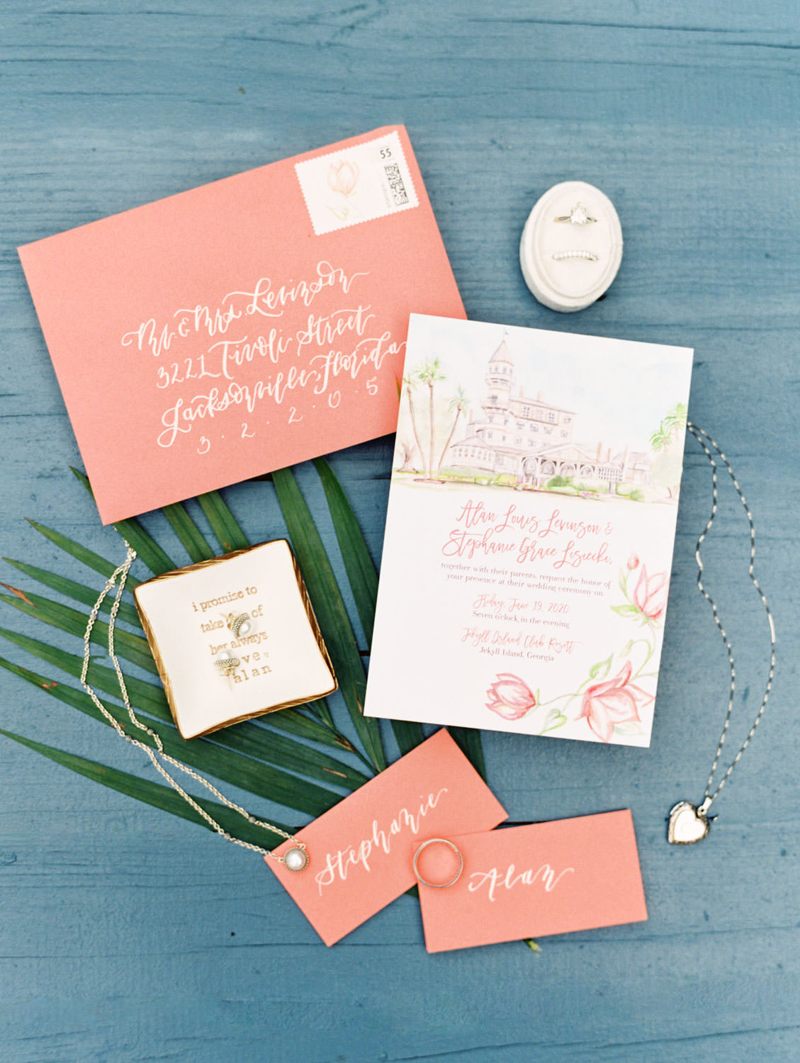 Custom illustrated venue on wedding invitations with coral colored envelopes. Wedding film photography at Jekyll Island Club Resort by Cavin Elizabeth Photography